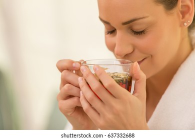 woman drinking herbal hot drink