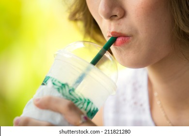 Woman drinking iced coffee