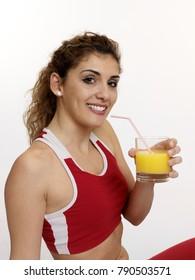 Woman drinking a juice.
