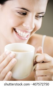 Woman drinking a mug of tea