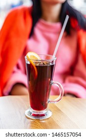 woman drinking mulled wine with orange