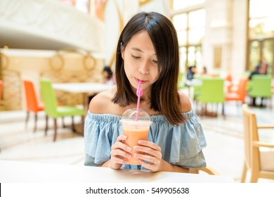 Woman drinking in restaurant