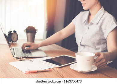 woman drinking some coffee and typing find job.