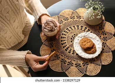 Woman drinking tasty frappe coffee with cookies in cafe