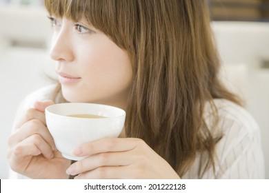 The woman drinking tea