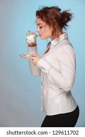 Woman drinking tea from a beautiful cup on Food and Drink theme