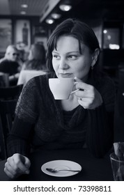 Woman drinking tea in a cafe