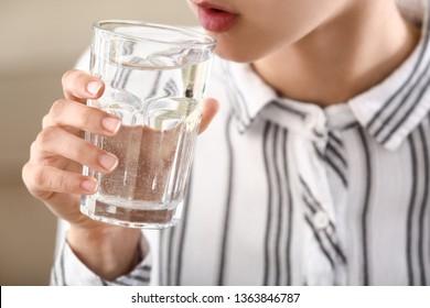 Woman drinking water, closeup
