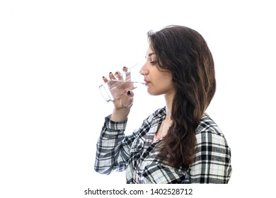 Woman drinking water from glass isolated on white