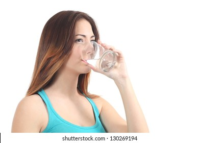 Woman drinking water from a glass on a white isolated background