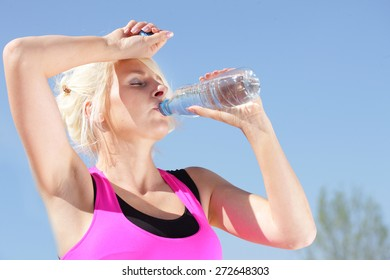 Woman drinking water in hot weather