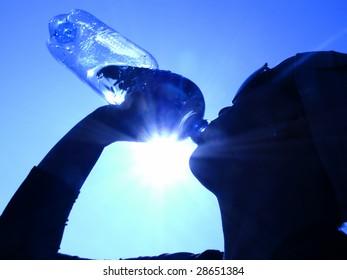 woman drinking water in the sun