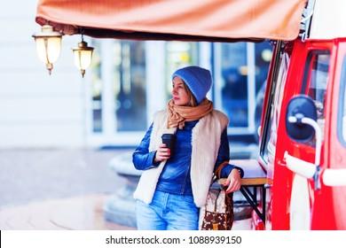 woman drinks coffee to takeaway, foodtruck