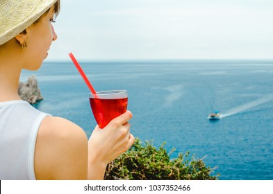 Woman Drinks Holds Cold Refreshing syrup Fresh Juice Drink sweet Straw Cherry Berries Fruit Summer Beach Island Sea Mood cocktai cranberry ice drink mountains background Diet Healthy detox vegeterian