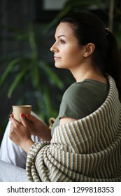 Woman drinks tea at home