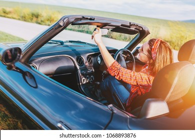 Woman drive a cabriolet car