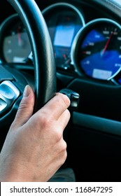 Woman drive car and holds the steering wheel