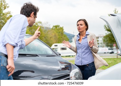 Woman driver and angry man arguing about the damage of the car