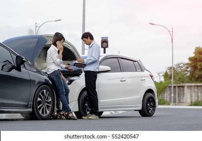 Woman driver calls for instruction during insurance agent review the dammage of the car after accident