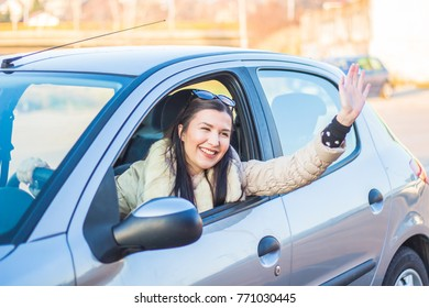 woman driver in the car give salute gesture.