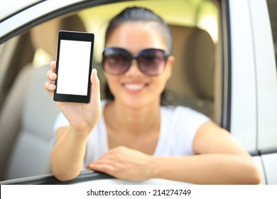 woman driver hold blank cell phone in car