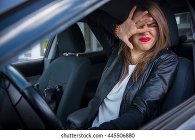 Woman driver scared shocked before crash or accident hands out of wheel