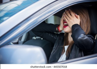 Woman driver scared shocked before crash or accident closing her eyes