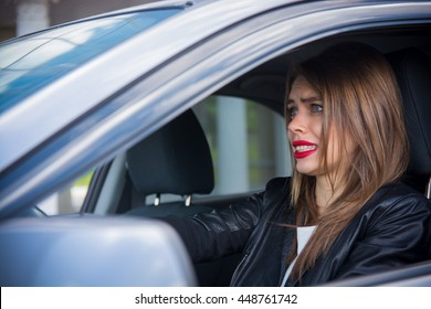 Woman driver scared shocked before crash or accident