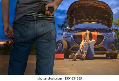 woman driver upset in the car problem on roadside at the dark of night alone, thief going to rob woman driver in foreground, worse situation for woman stay alone
