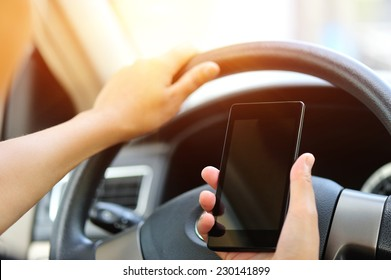 woman driver use her cell phone driving  car