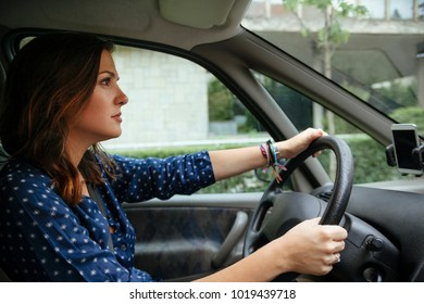 Woman Driving A Car In The City
