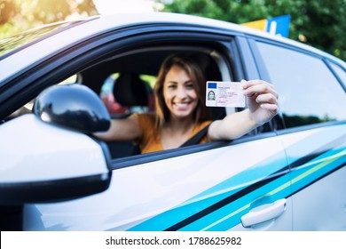Woman with driving license. Driving school. Young beautiful woman successfully passed driving school test. Female smiling and holding driver's license. - Shutterstock ID 1788625982