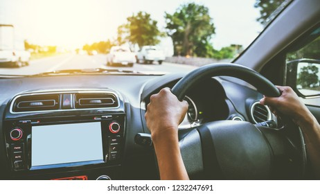 Woman driving a map to direct sunlight in the evening.