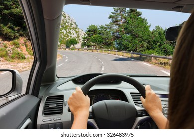 woman driving modern  car on country road, view  inside out