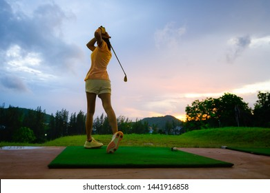woman driving practice golf training for a better hit in course, practice for winning competitive