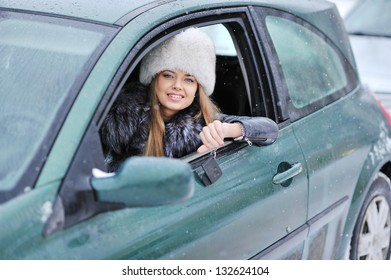 Woman driving showing car keys out the window