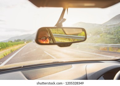 Woman driving at sunrise