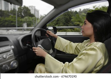 Woman driving,concentrating on road ahead