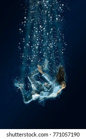 Woman is drowning under water. Horrible dream
