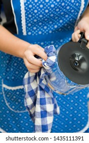 A Woman Drying a Coffee Pot