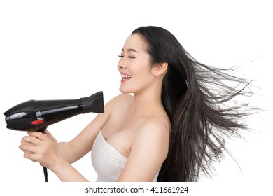 woman drying hair with hair dryer