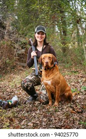 Woman Duck Hunter Portrait with Labrador and Decoys