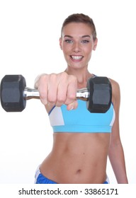 woman with dumbell and smiling