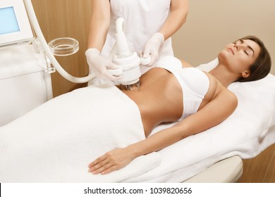 Woman during belly massage or figure correction procedure