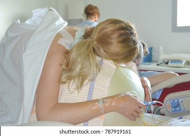 Woman during contractions on a fitness ball Parturition hospital