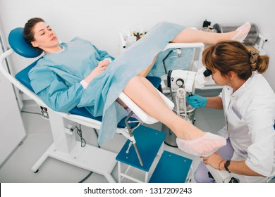 Woman during examination by a gynecologist. Having advise with her gynecologist. colposcopy