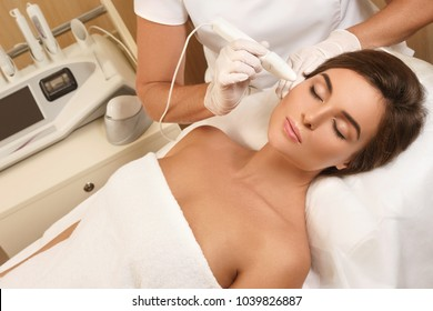 Woman during face skin diagnostic in the professional beauty salon