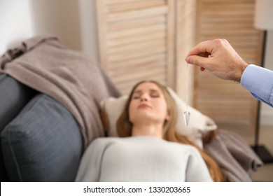 Woman during hypnosis session in psychologist's office
