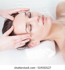 Woman during nice face massage in spa