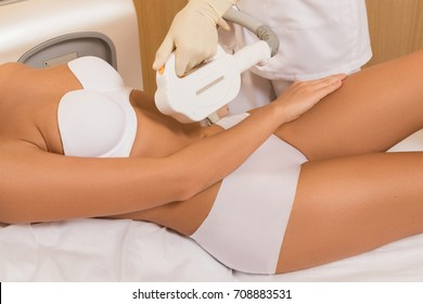 Woman during photoepilation procedure